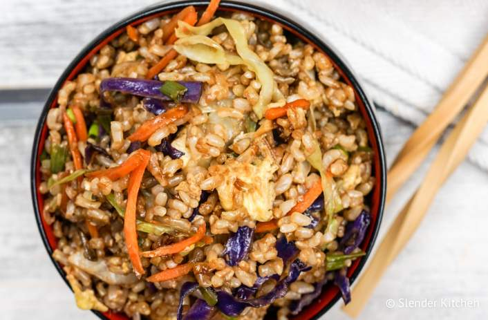 Healthy fried rice made with brown rice, eggs, cabbage, carrots, ginger, and garlic.