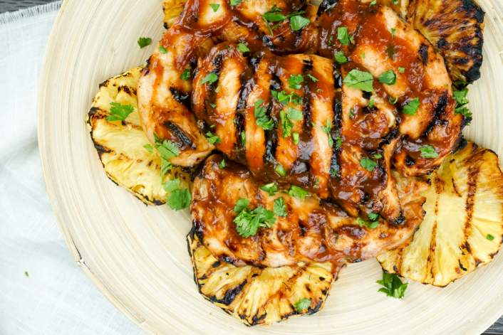 Grilled Pineapple Barbecue Chicken on a plate with cilantro.