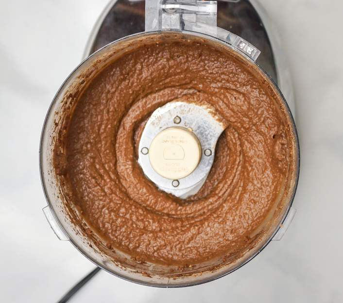 Brownie Batter Chocolate Hummus in a food processor.
