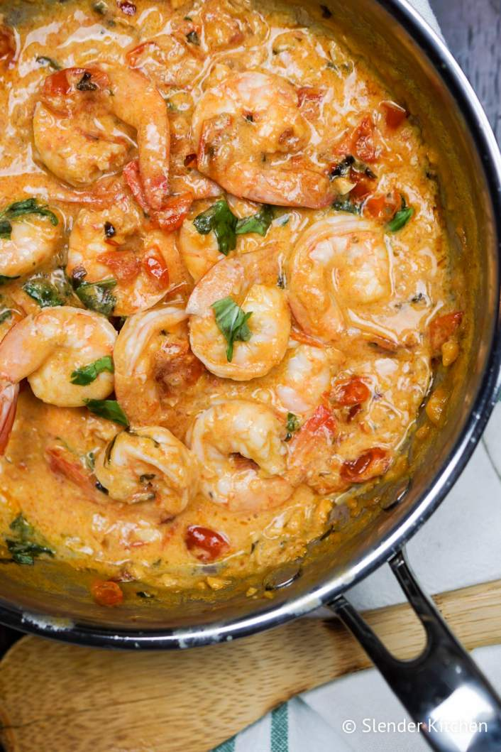 Weight Watchers Coconut Shrimp and Tomatoes in a creamy sauce in a pan.