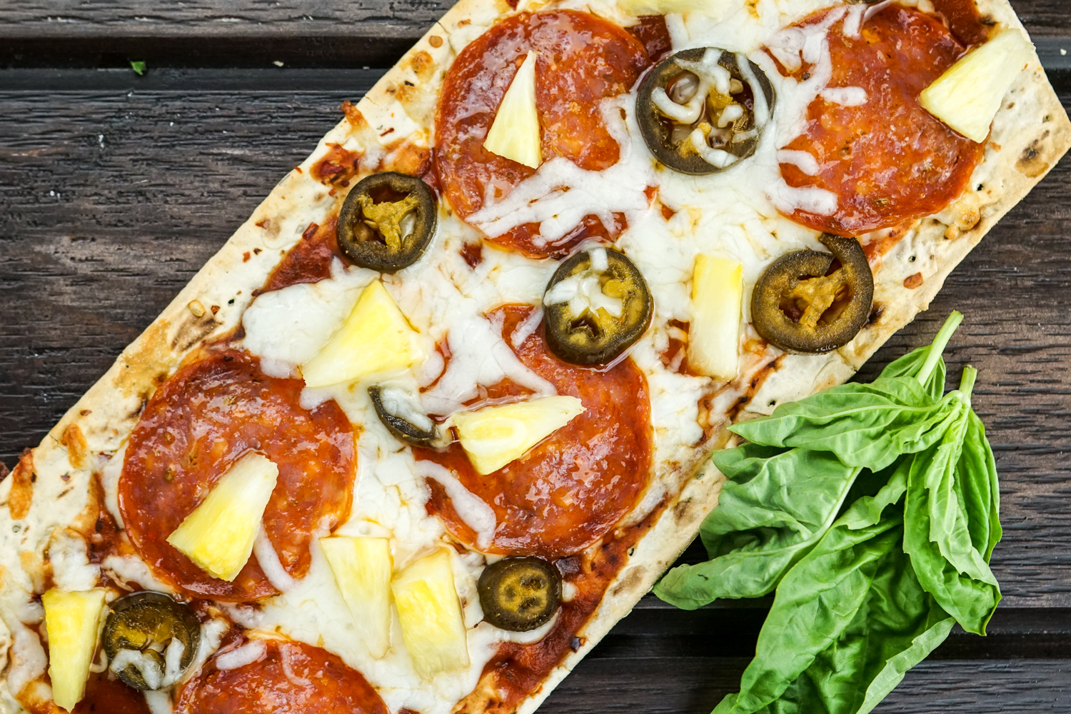 Pepperoni and Pineapple Pizza with Jalapenos for a healthy appetizer.