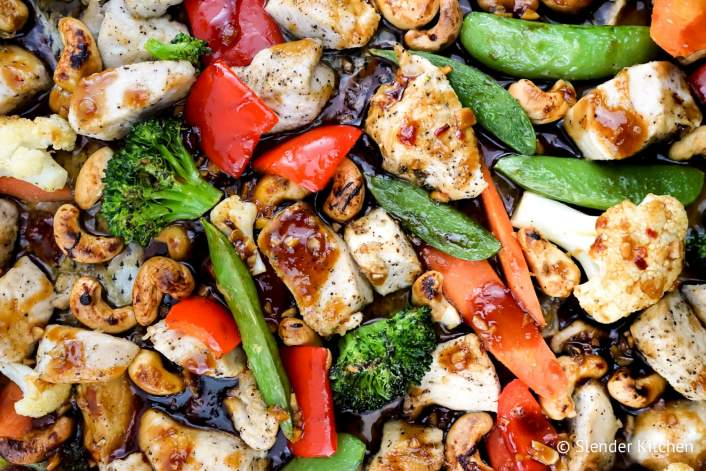 Thai Cashew Chicken and Vegetables on a sheet pan with a sticky sweet and spicy sauce.