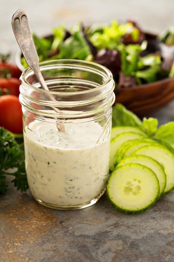 Weight Watchers Ranch Dressing in a mason jar with lettuce in the background.